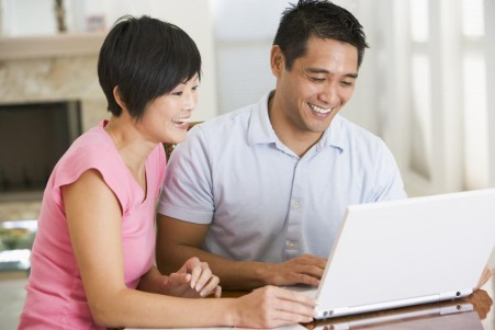 asian-couple-on-laptop-8-Most-Valuable-Tips-from-a-Renovation-Contractor